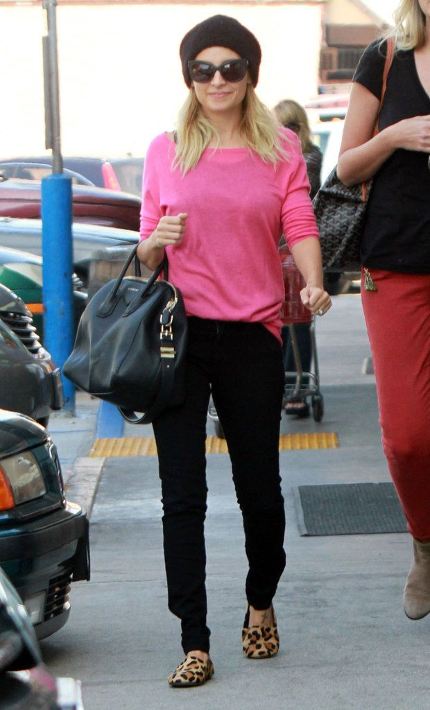 Nicole took a shopping trip in a hot pink sweater, black jeans, and chic leopard-print loafers in November 2011.