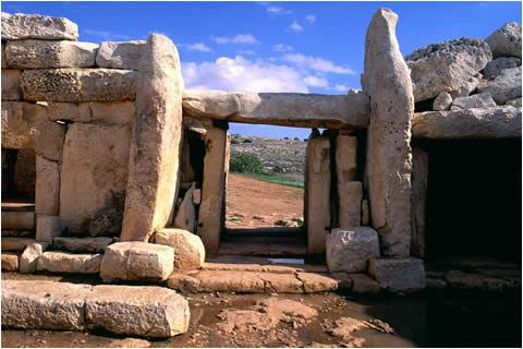 """The Mnajdra Temples are three conjoined Neolithic temples on the southern coast of Malta. Dating from about 3000 BC, Mnajdra is reminiscent of the even earlier complex at Ggantija on Gozo.    Mnajdra (""""mna-ee-dra"""") is less than 1 km downhill from the Hagar Qim temple complex. The two complexes seem to have built at different times, and their relationship is not known."""
