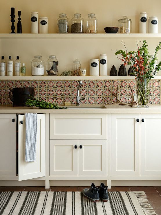 Cottage Kitchen With White Lower Cabinets, Pink And Blue Mosaic Tile  Backsplash, And Shelf