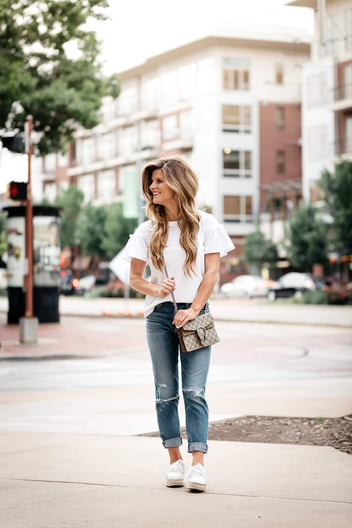 85d890a551c White ruffle sleeve top + distressed jeans + espadrille sneakers