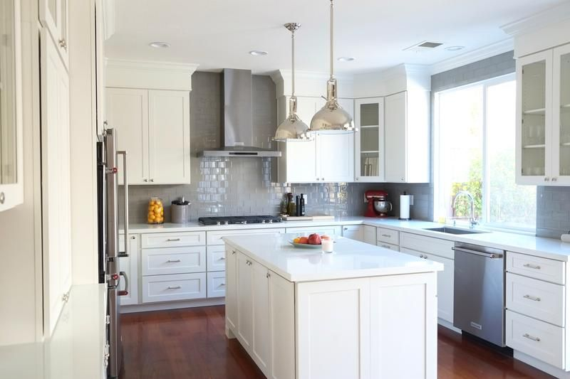 Industrial luxe kitchen design features white shaker cabinets, white ...