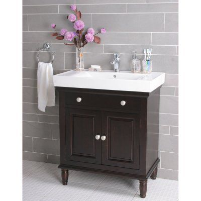 Love this vanity and the variegated tile wall is rad.