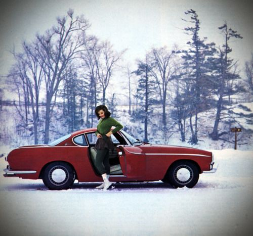 Red Volvo P1800 And Lady In The Snow