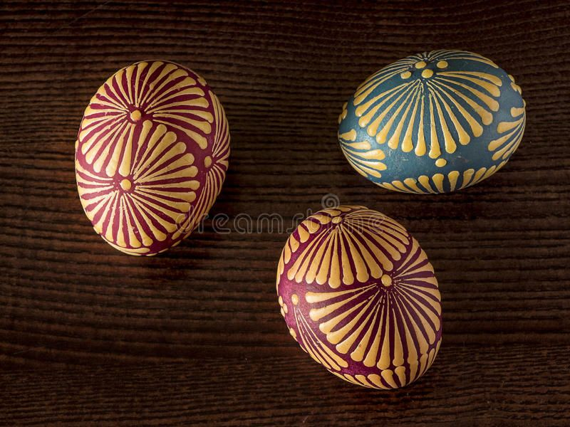 Easter eggs. Three painted Easter eggs on a dark wood texture background.. Decor , #Aff, #dark, #wood, #texture, #Easter, #eggs #ad #woodtexturebackground