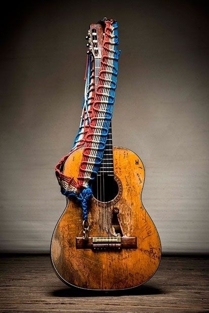 """Willie Nelson's beloved 1969 Martin N-20 classical guitar, named """"Trigger"""". The hole is from decades of strumming-wear with a pic. Collected signatures include Leon Russell, Roger Miller, Kris Kristofferson, Gene Autry, Johnny Cash, Waylon Jennings, lawyers, football coaches, and other friends and associates."""