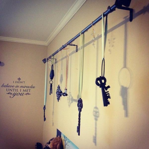 I used decorative keys, ribbon and a curtain rod to make a ...