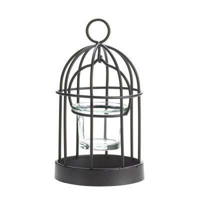 """Description The perfect perch for a candle! This charming iron birdcage candleholder features a glass candle cup, charming wire-frame design, and a hanging loop at top. Place a candle inside and light it to enjoy its cheery charm.  Specification Candles not included.  Material and Dimensions Iron and glass.  3 3/4"""" x 3 3/4"""" x 7"""" high"""