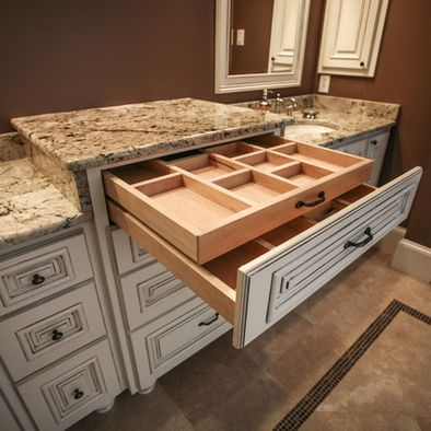 This Bathroom Jewelry Cabinet is amazing (minus the dated marble counter top). It's much larger and more than I'd ever need. It's just missing one thing... a built-in vanity with a bench seat to do hair and make-up.
