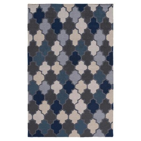 Anchor your living room seating group or define space in the den with this chenille and wool rug, featuring a quatrefoil motif for a pop of pattern....