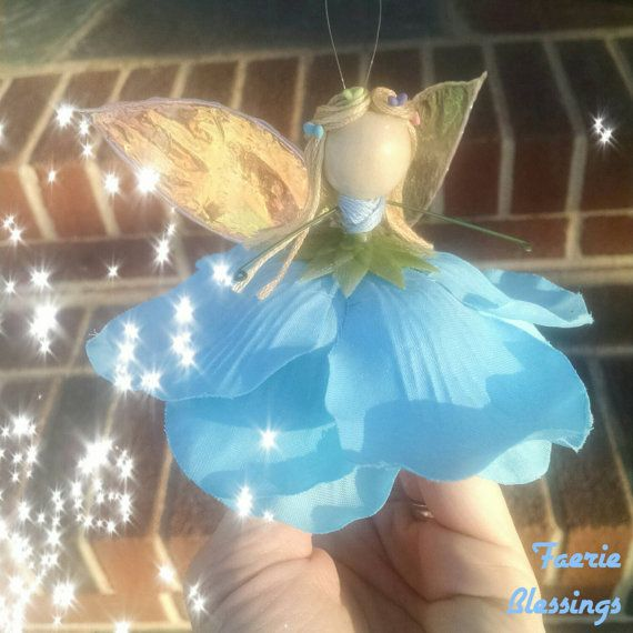 Ella Who's excited for the new Cinderella movie?  Just listed in my shop, glass slippers and all!  #faerieblessings #etsy #cinderella #ella #disney #disneyprincess #movie #disneymovie #fairygodmother #handmade #forsale  Check out this item in my Etsy shop https://www.etsy.com/listing/224008247/cinderella-fairy-ornament-magic-fairy
