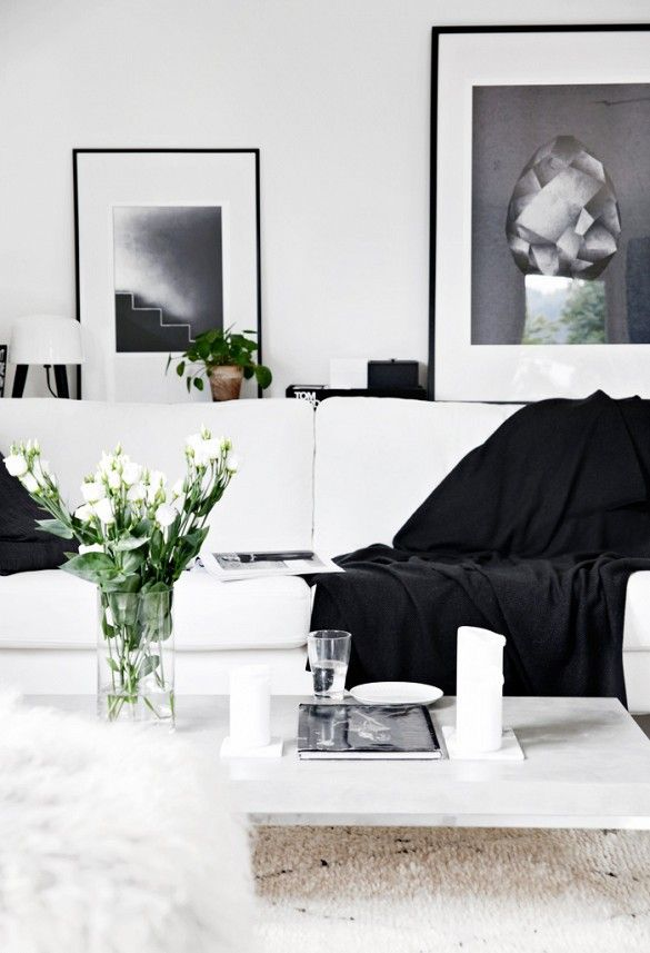 Casual black and white living room with black throw