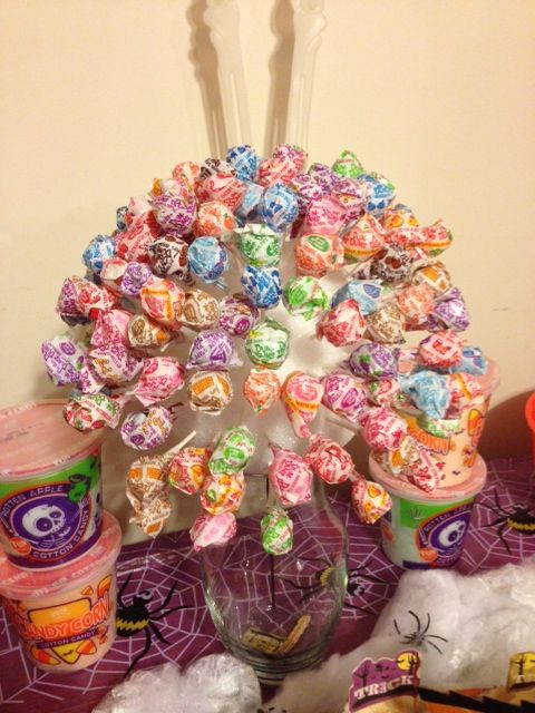 Lollipop Tree -- a centerpiece for the candy bar, this was also very simple: one 7-inch Styrofoam sphere from the craft store, two 80-count bags of Dum Dums lollipops, and a vase.  Also recommend adding a thin stick into the sphere for balance/support in the vase #HalloweenParty2013