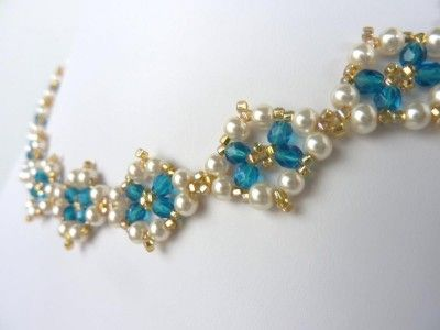 Free beading pattern of pearls and crystals woven into a lovely diamond motif. Motif can be used for earrings, bracelet, or necklace.