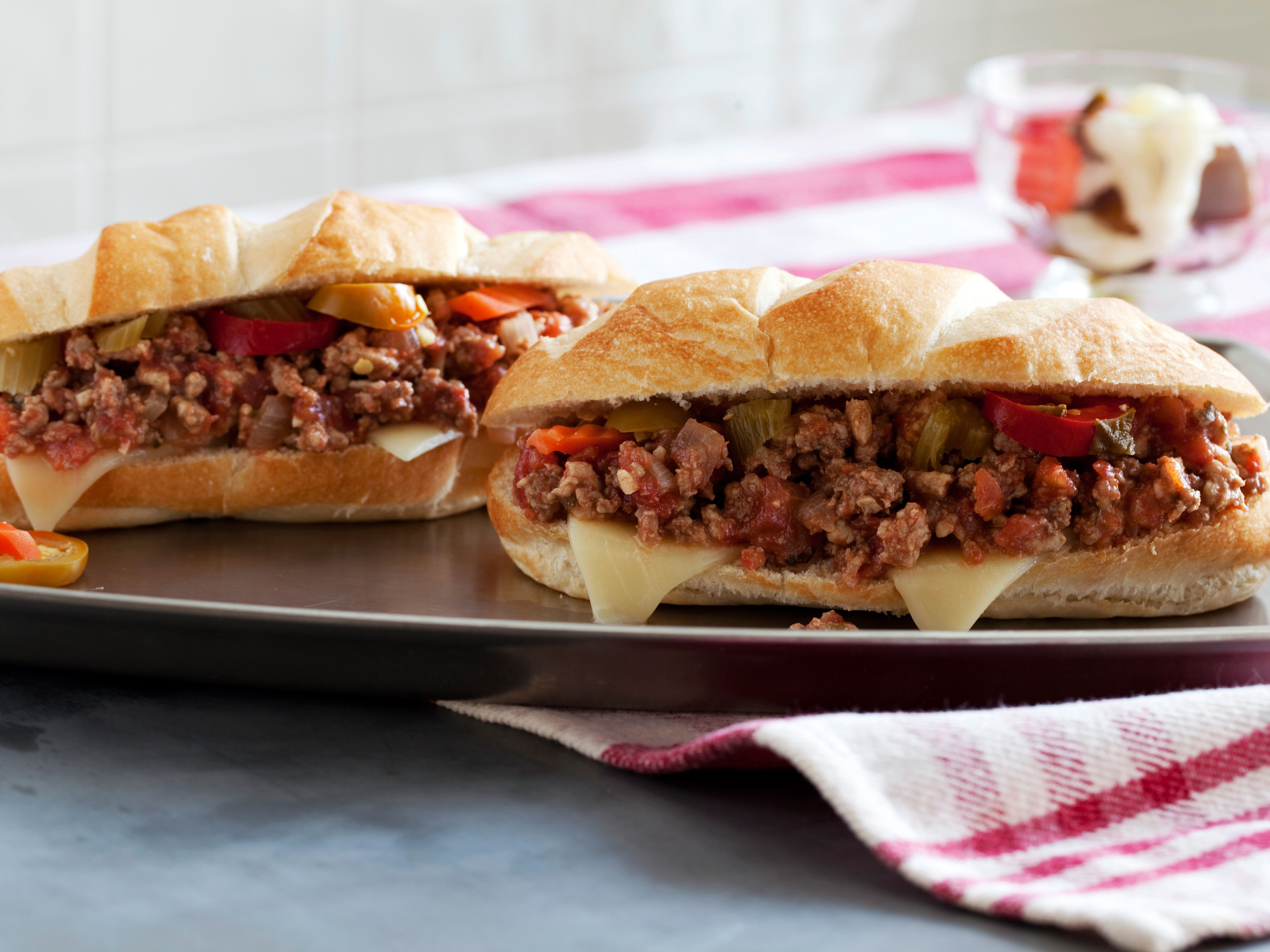 """The Sandwich King's Italian Sloppy Joes : Jeff Mauro says, """"This is a classic bolognese, sloppied and turned into an awesome sandwich."""" You can make it up to two days in advance and double the recipe for a crowd. And feel free to substitute ground turkey or all beef for the beef, pork and veal combo this recipe calls for."""