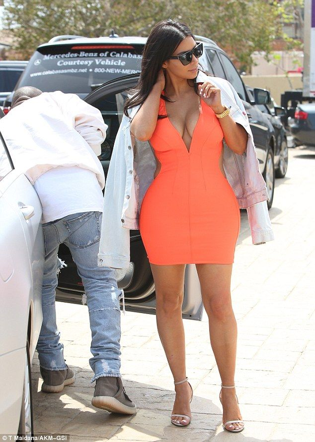 ae34ad3dcfcfc8 Body con  Kim Kardashian showed off her curves in a skintight orange dress  while on a lunch date with husband Kanye West in Malibu on Saturday