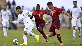 Greece's midfielder Kostas Katsouranis  (L) vies with Portugal's forward Silvestre Varela (C) and Portugal's midfielder Miguel Veloso