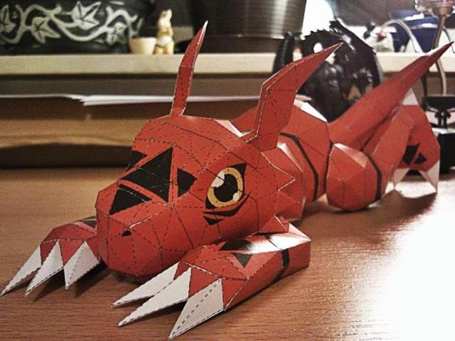 Digimon - Guilmon The Dino Paper Model - by Podragon - == -  From Anime Digimon, here is Guilmon, the Dino, in a nice paper version created by designer Podragom, from Papermon website. Guilmon is a Rookie-level virus digimon with the appearance of a dinosaur with winged ears. He is red with a white belly and black virus and biohazard symbols about his body. The beautiful model that you see in the photo above was assembled by modeler Destro2K.
