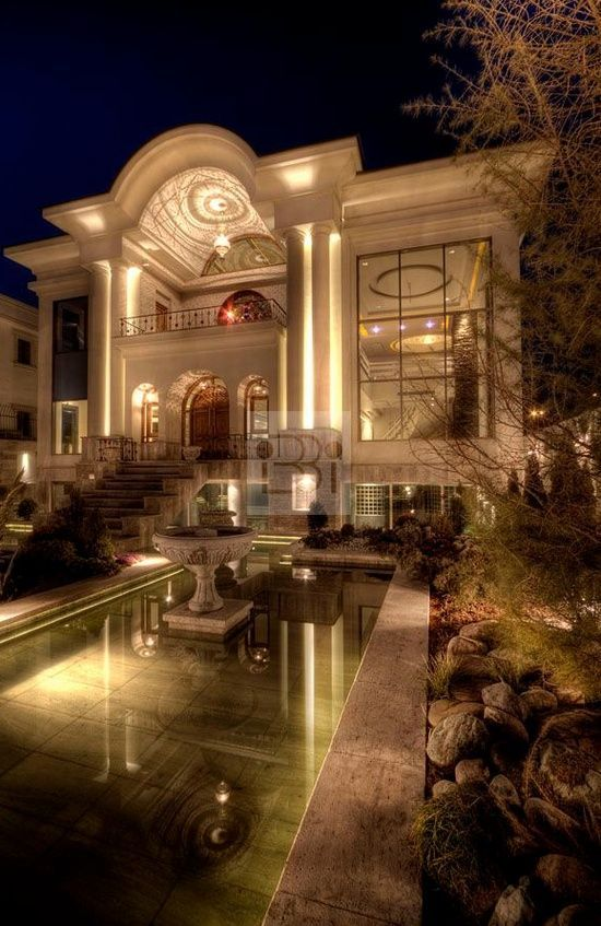 Luxurious Home With Grand Design, Nice Pillars Surrounding The Entrance Of  The Home, And Beautiful Placement Of Balcony Above.
