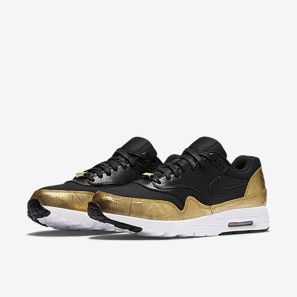 Nike Air Max 1 Black and metallic leather overlays. Nike Shoes Sneakers