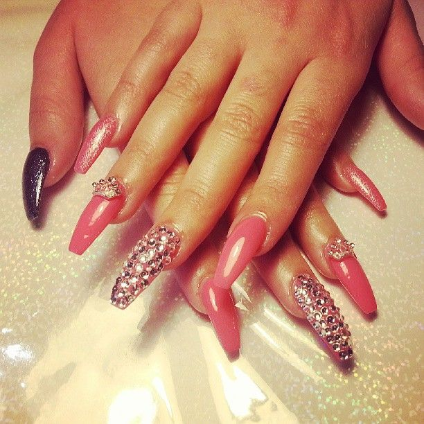 This is a new nail shape style called Coffin nails. Not big on the ...