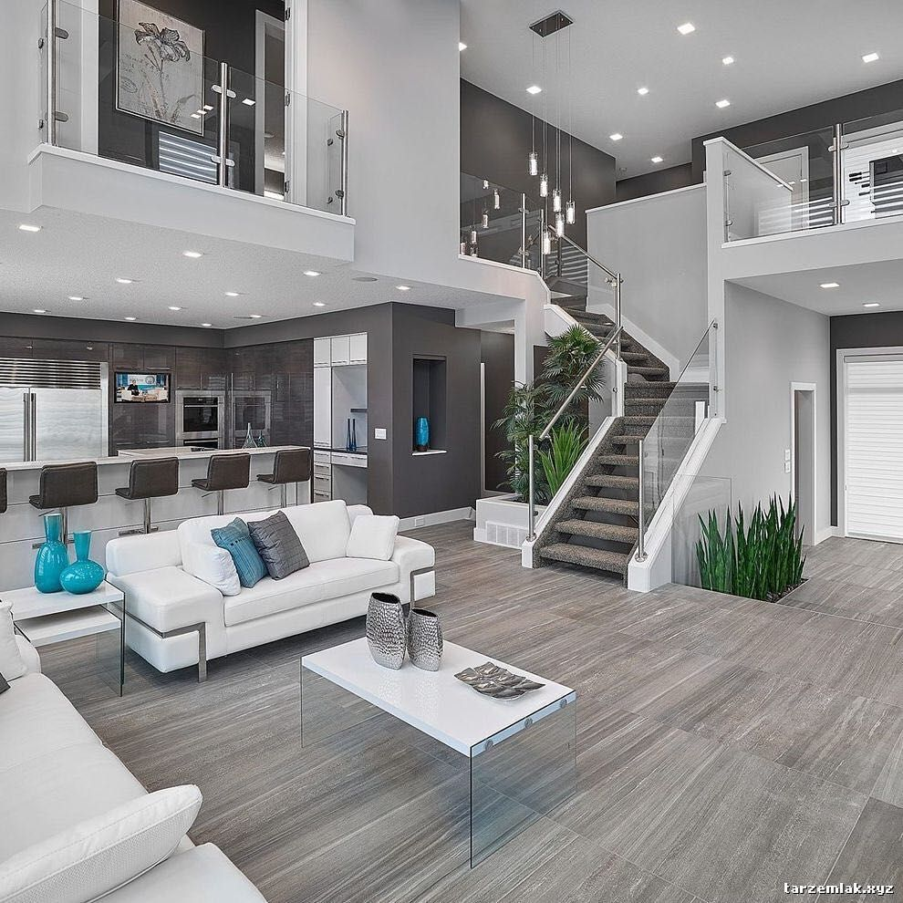 Open Concept Living Room Kitchen With Gray Walls Hardwood Floors Flawlessly Placed Blue And Green Accents To Bring A Splash Of Color