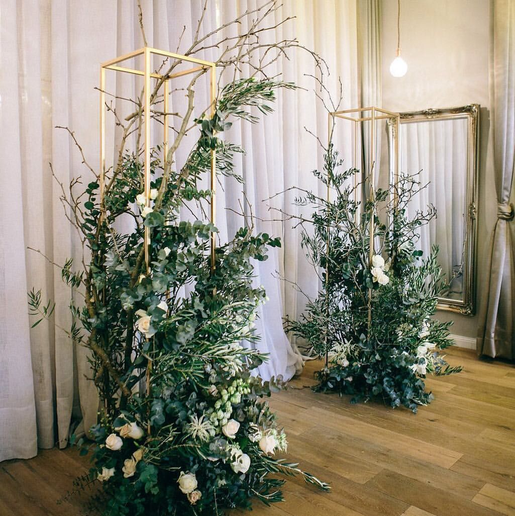 Over the top wedding decorations  Arbour inspo but with flowers coming from the top of some of the