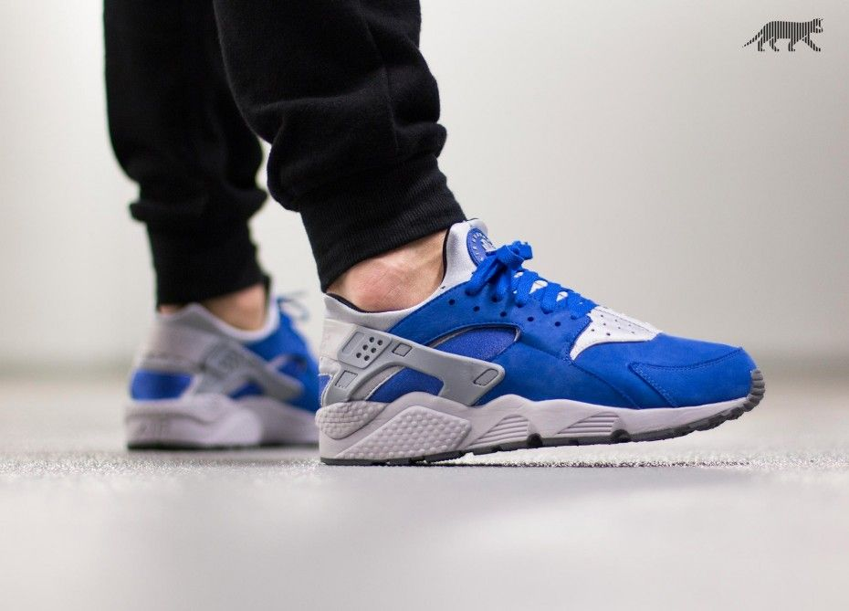 Nike Sportswear nixes the mesh for its latest release of the Air Huarache.  For the drop, the sneaker is suede and neoprene built in a varsity royal  base wi