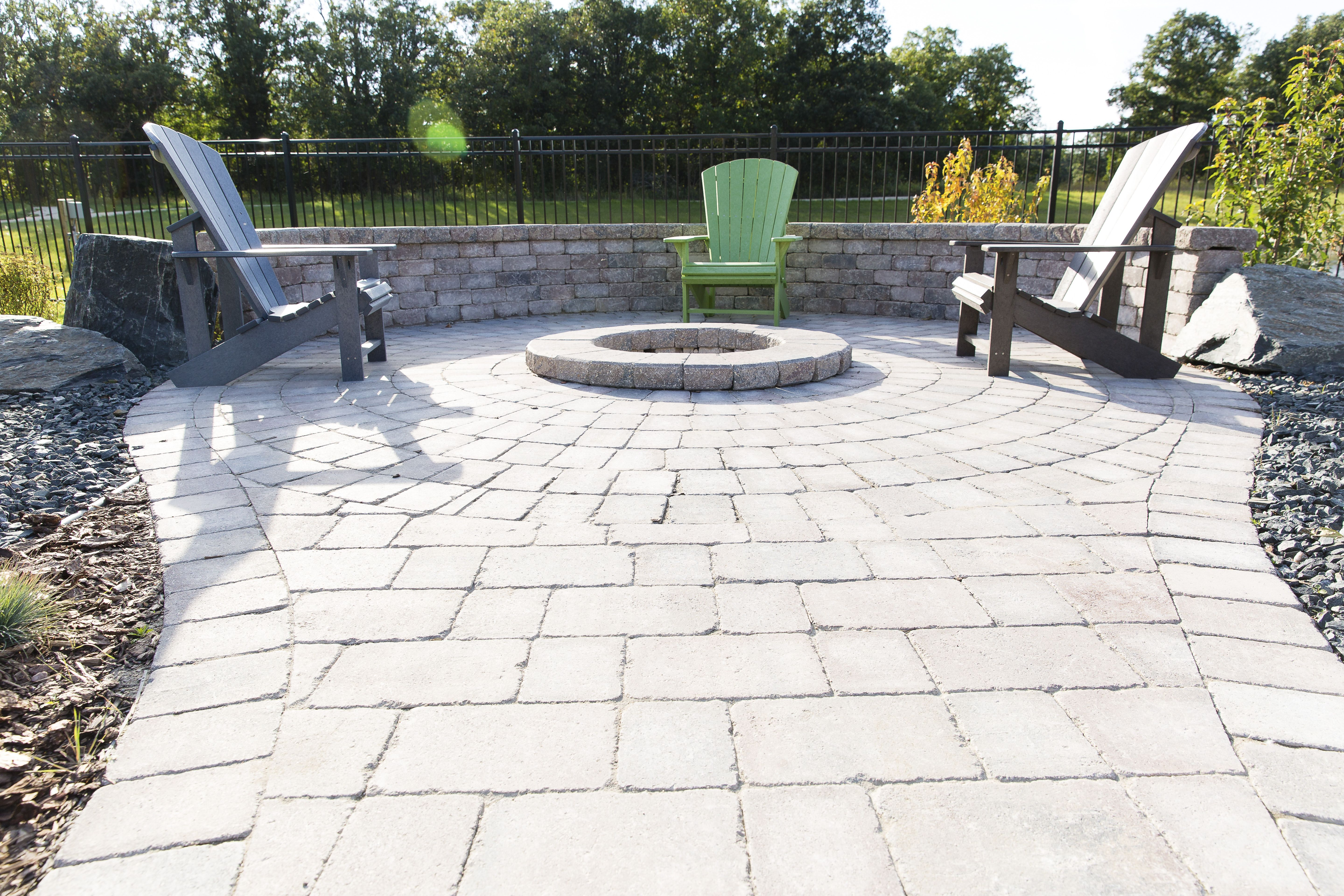 Custom Circle Fire Pit Inlaid In A Roman Paver Patio Paver Patio Outdoor Fire Pit Patio
