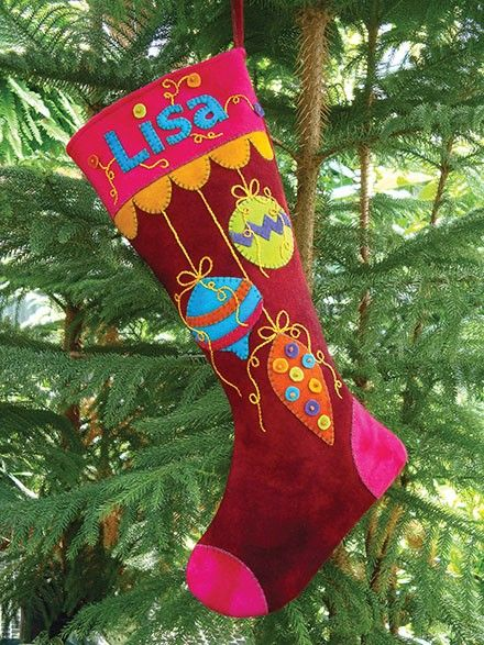 Wool holiday stocking with monogram, appliqué and buttons.