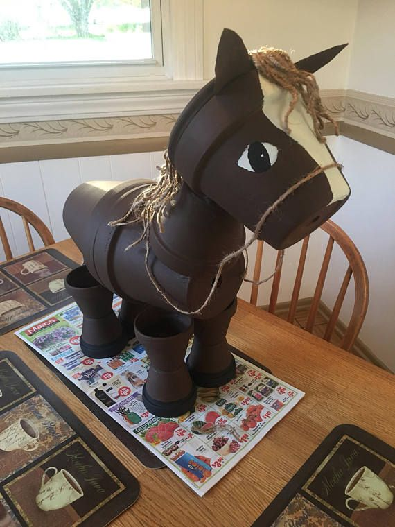 Made To Order Clay Pot Horses that can be painted any color. It is about 3 feet tall and 3 feet wide. We welcome pictures of your pets for us to copy for you