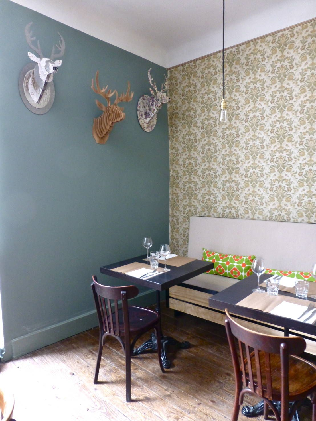 super cute cafe style dining room with wallpaper and blue feature wall with fake dear - Blue Cafe Decorating