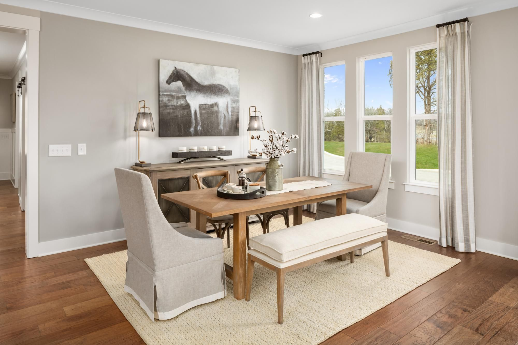 Drees Homes Kinsley Dining Room With Hardwood Flooring And Beige