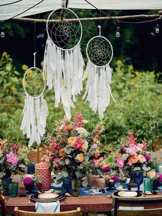 07 bold boho table setting with colorful florals and textiles white dreamcatchers we on boho chic kitchen table decor id=90755