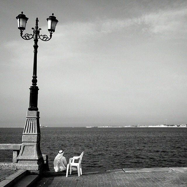 A Man Setting Alone And Contemplates The Sea Photo By Mohddesigner In Dammam Corniche رجل يجلس وحيدا متأملا البحر تصوير M Man Set Landmarks Tower