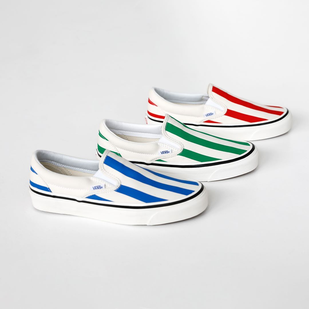 Stand out in a pair of striped Vans Classic Slip Ons. Get
