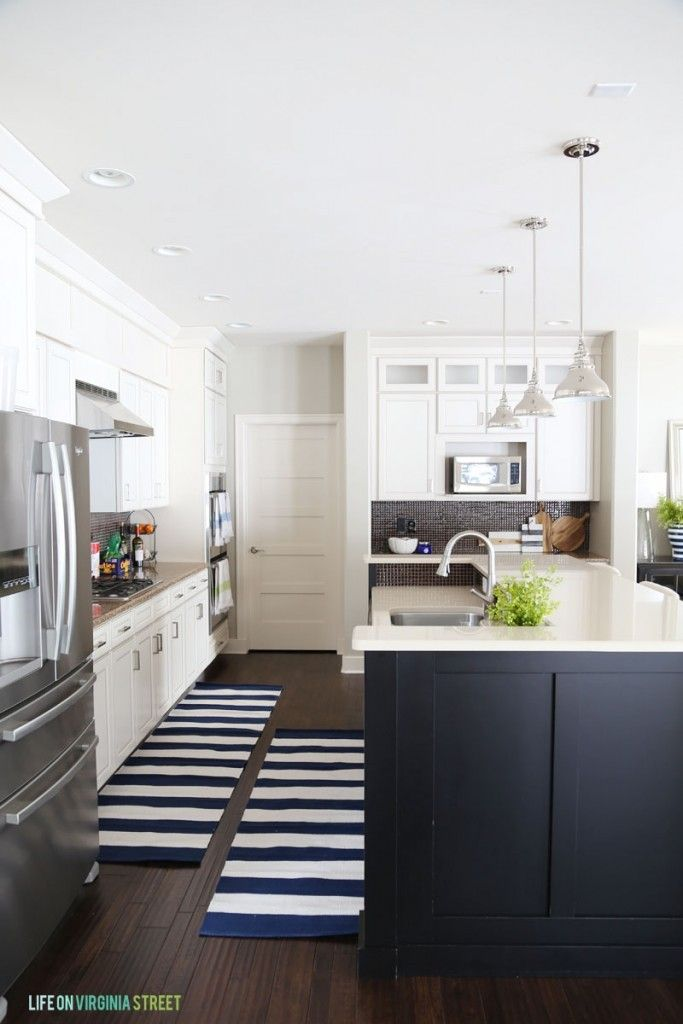 White Kitchen With Black Island And Navy Striped Runner Rugs Love These Tips On How To Add Life Your Decor In The Dead Of Winter Via Virginia