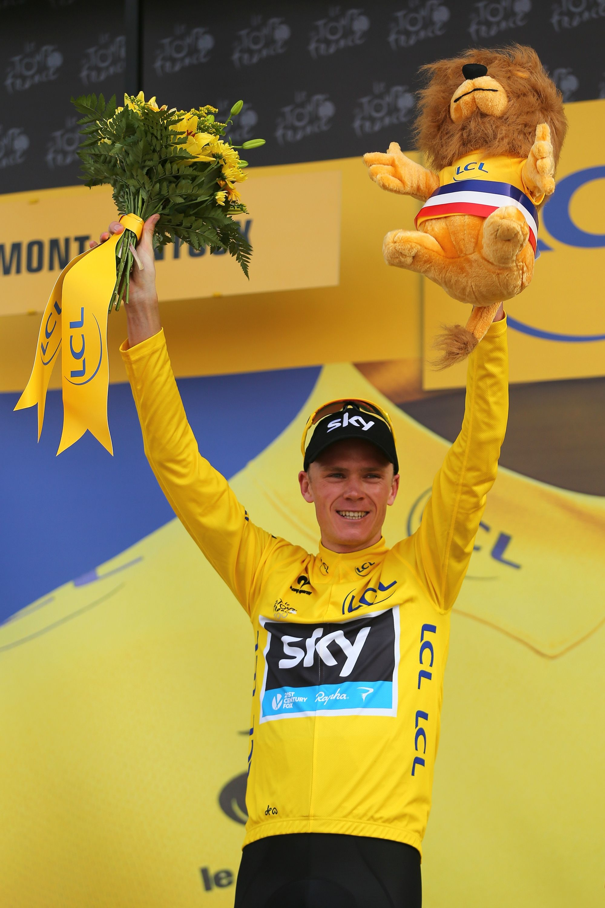 MONT VENTOUX, FRANCE - JULY 14: Current race leader and wearer of the Maillot Jaune, Chris Froome of Great Britain and SKY Procycling celebrates on the podium after winning stage fifteen of the 2013 Tour de France, a 242.5KM road stage from Givors to Mont Ventoux, on July 14, 2013 on Mont Ventoux, France. (Photo by Bryn Lennon/Getty Images)