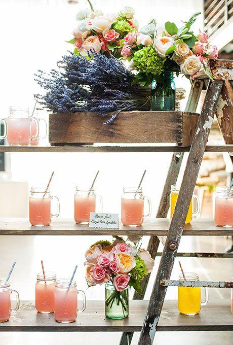 Brides.com: . Tasty signature drinks, like Passion Fruit and Ginger Beer Sparklers, are displayed in on a vintage ladder-turned-shelves.