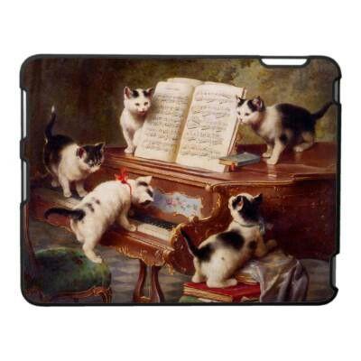 Kittens playing piano