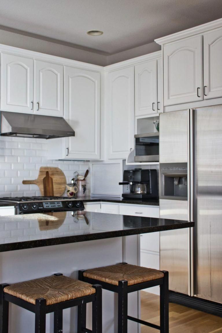 These kitchen cabinets were painted BM Simply White.  We put together a post on our favorite Benjamin Moore white paint colors (and when to use them) with their Sherwin Williams and Behr matches. Our favorites are White Heron, Chantilly Lace, Simply White, Swiss Coffee and Classic Gray. #paintcolorideas #bestpaintcolors #whitekitchens #whitepaintcolors #whitepaint #thecolorconcierge #Benjaminmoore #sherwinwilliams #behr #thecolorconcierge #paintingkitchencabinets #swisscoffeebenjaminmoore These #swisscoffeebenjaminmoore