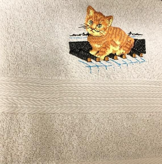 Beautiful white hand towel - ideal Christmas  present. Embroidered ginger kitten on piano keys, towel size 36 in x 20in #gingerkitten