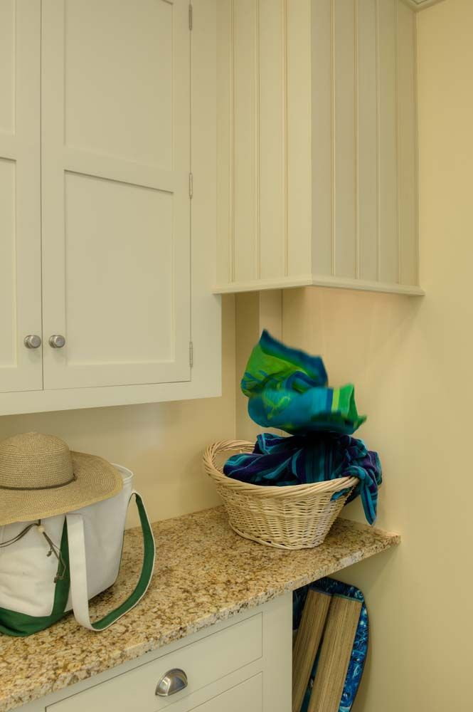Laundry chute!  Crown Point Cabinetry Laundry #16