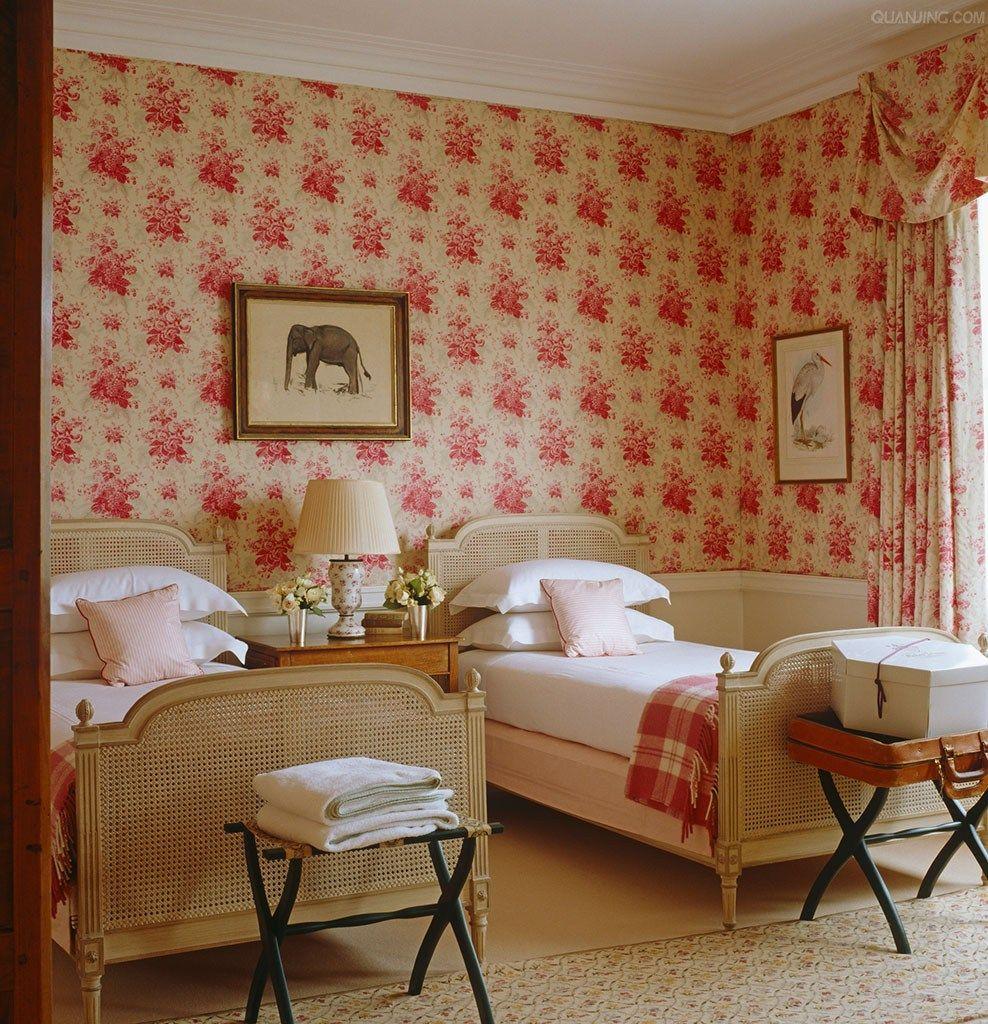 Twin bed bedroom, wallpaper, french beds, animal art.  Photographer: Fritz von der Schulenburg Designer/Stylist: Emily Todhunter