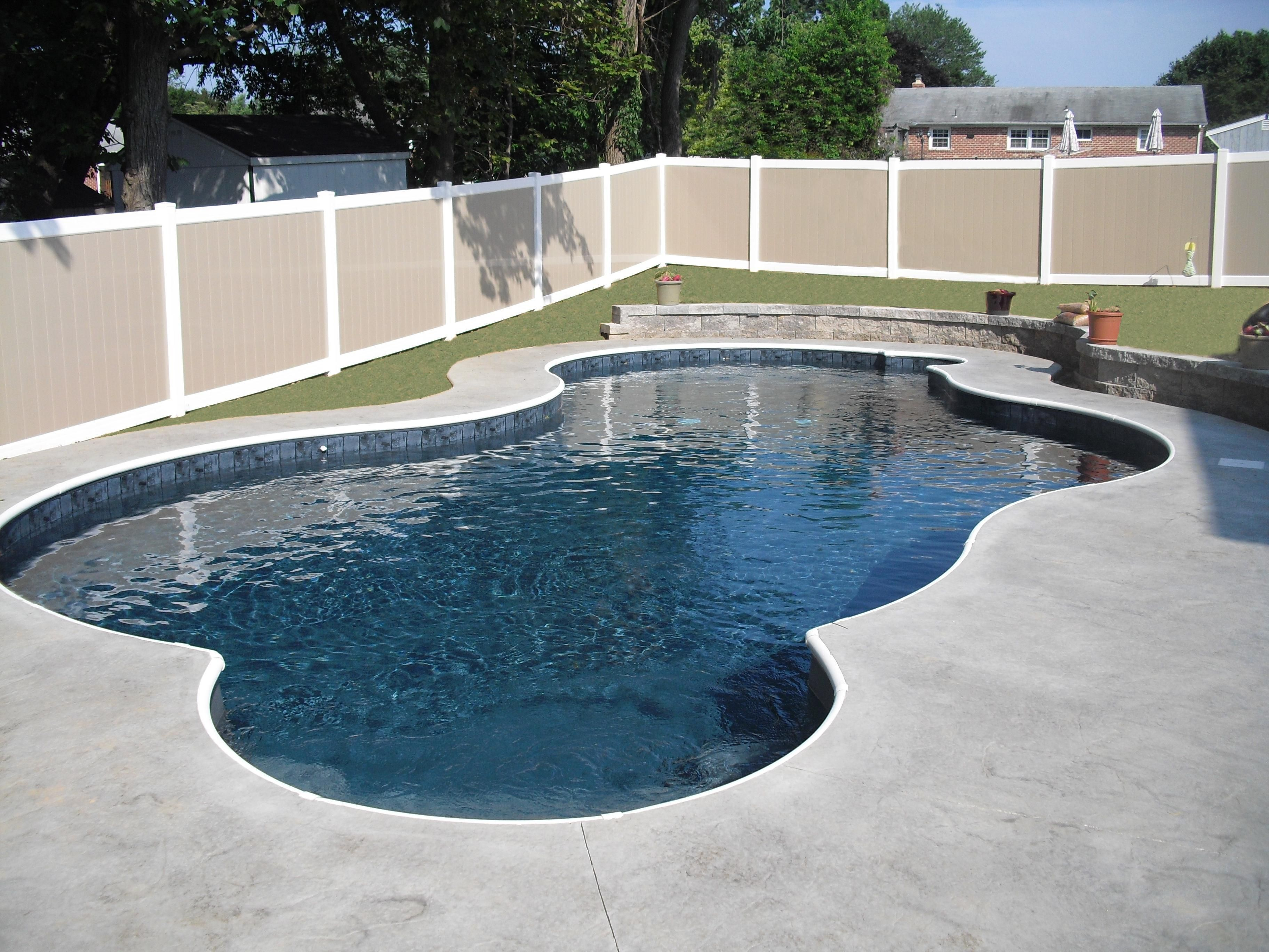 freeform with black liner grey steps and retaining sitting wall our beautiful swimming pools