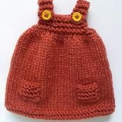 Dress for doll. PATTERN AVAILABLE AT CRAFTSY FOR SMALL CHARGE #knitteddollpatterns