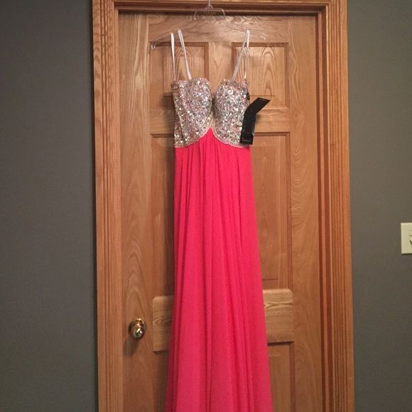 Jovani prom dress Chiffon sweetheart a-line gown featuring a sequin encrusted bodice and high to low waistline that segues into a full,poly chiffon skirt #151P0026 color is dark coral. Brand new with tags never worn Jovani Dresses Prom