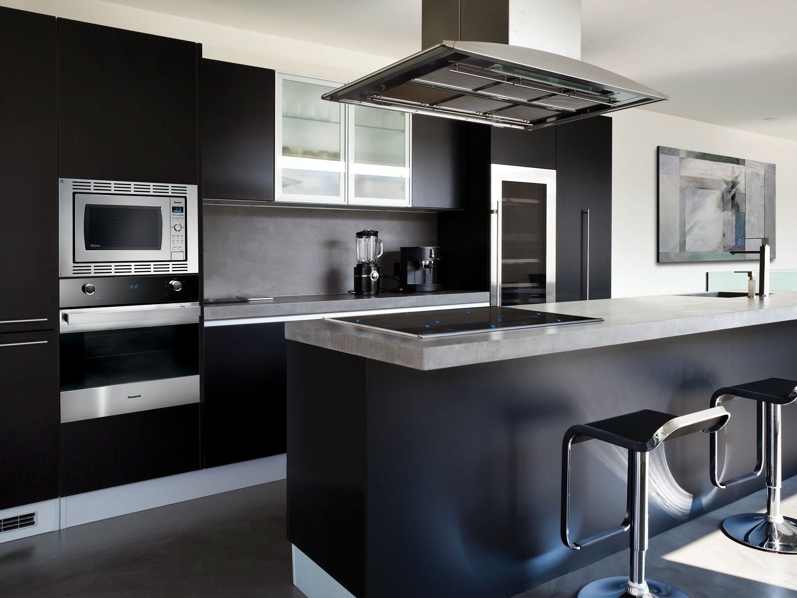 Interior Black Matte Kitchen Cabinet With Concrete Contertop Electric Stove And Oven Built In Dark