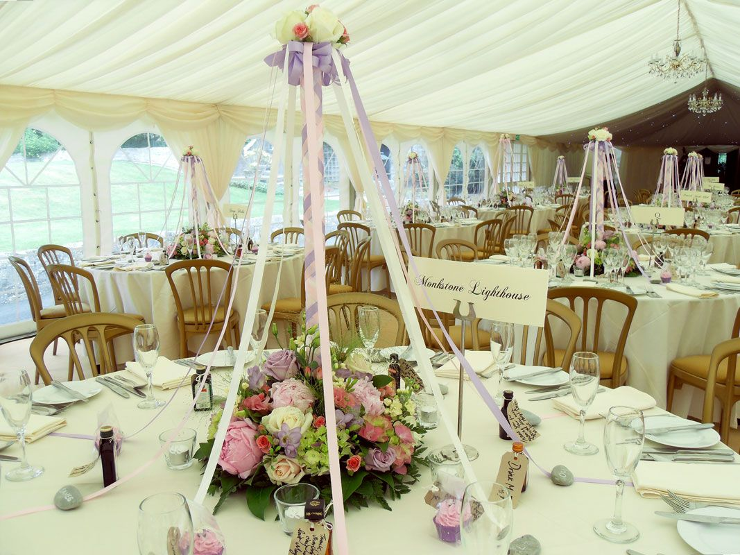 maypole themed table flower decoration at fonmon castle. | wedding