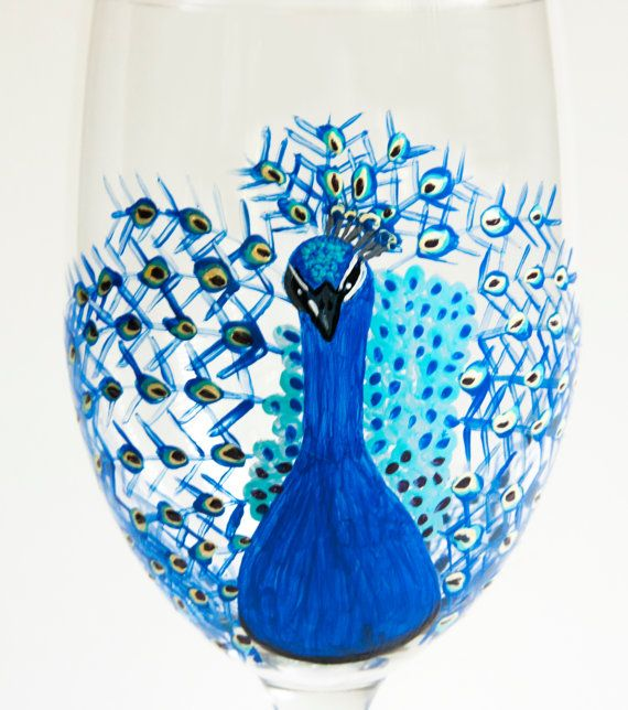 Check out this item in my Etsy shop https://www.etsy.com/listing/236728155/peacock-wine-glass-peacock-glass-hand