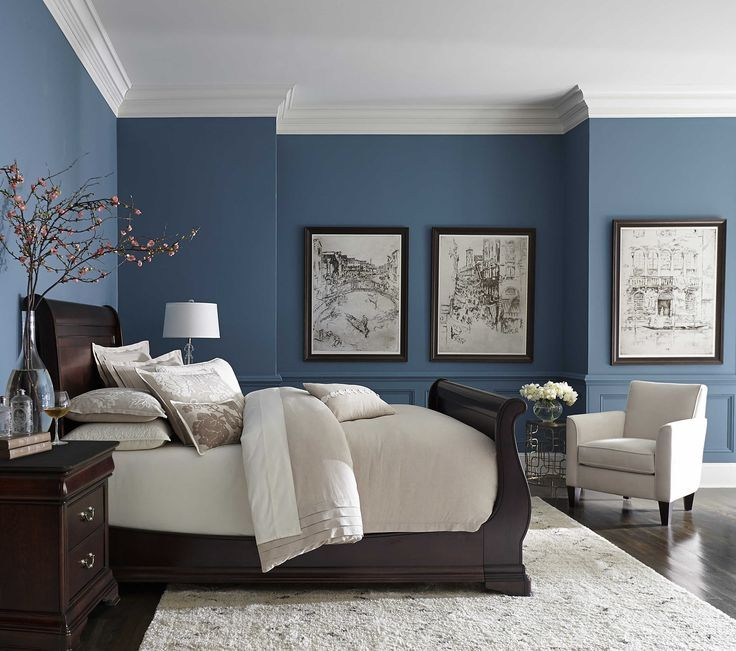 Pretty blue color with white crown molding inspiration for Matrimonial bedroom design